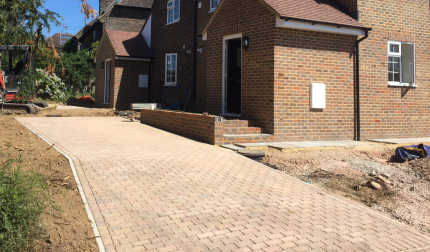 Natural Stretcher Bond Block Paved Driveway