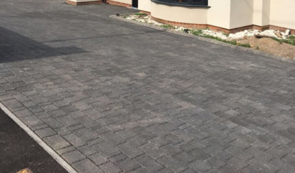 Grey Stretcher Bond Block Paved Driveway